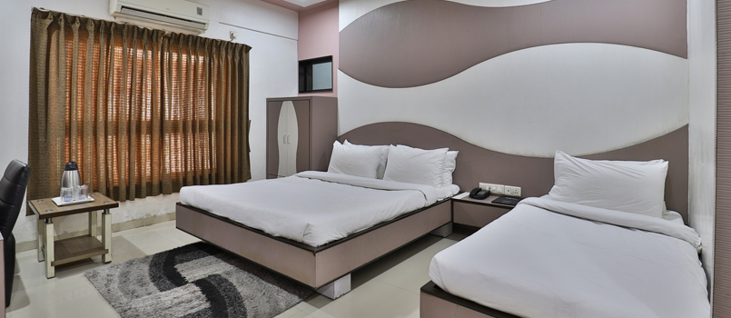 Nice interiored rooms at Hotel Merit Surat